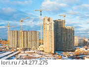 Купить «Строительство многоэтажных домов. Закат. Москва. Россия», фото № 24277275, снято 27 ноября 2016 г. (c) Екатерина Овсянникова / Фотобанк Лори