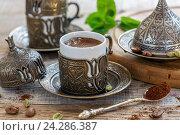 Купить «Ароматный черный кофе с кардамоном», фото № 24286387, снято 8 ноября 2016 г. (c) Марина Сапрунова / Фотобанк Лори