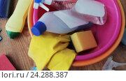 Купить «basin with cleaning stuff on wooden floor», видеоролик № 24288387, снято 3 ноября 2016 г. (c) Syda Productions / Фотобанк Лори
