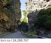 Купить «Извилистая дорога между скал к Чегемским водопадам», фото № 24288767, снято 18 августа 2006 г. (c) Евгений Ткачёв / Фотобанк Лори