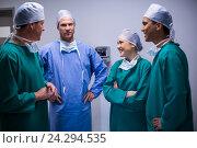 Купить «Surgeons having discussion in corridor», фото № 24294535, снято 11 сентября 2016 г. (c) Wavebreak Media / Фотобанк Лори