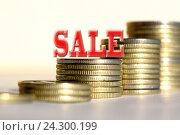 "Купить «Символ ""sale"" на фоне столбиков монет», фото № 24300199, снято 22 октября 2016 г. (c) Сергеев Валерий / Фотобанк Лори"