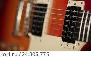 Купить «Электрическая гитара», видеоролик № 24305775, снято 30 октября 2016 г. (c) Швец Анастасия / Фотобанк Лори