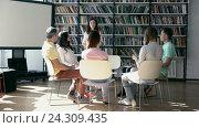 Купить «Young woman is training a group of people», видеоролик № 24309435, снято 19 августа 2016 г. (c) Raev Denis / Фотобанк Лори