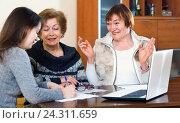 Купить «Senior glad women making will at public notary office», фото № 24311659, снято 26 июня 2019 г. (c) Яков Филимонов / Фотобанк Лори
