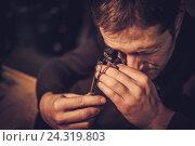 Купить «Jeweler during the evaluation of jewels», фото № 24319803, снято 2 декабря 2016 г. (c) Andrejs Pidjass / Фотобанк Лори