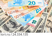 Money background from american dollars and euro banknotes, фото № 24334135, снято 4 декабря 2016 г. (c) FotograFF / Фотобанк Лори