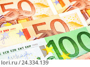 Background from different euro banknotes close up, фото № 24334139, снято 5 декабря 2016 г. (c) FotograFF / Фотобанк Лори