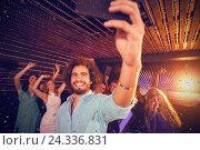 Купить «Composite image of man taking a selfie from mobile phone while friends dancing on dance floor», фото № 24336831, снято 26 июня 2019 г. (c) Wavebreak Media / Фотобанк Лори