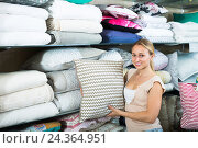 Купить «Cheerful woman customer buying fluffy pillow», фото № 24364951, снято 22 мая 2018 г. (c) Яков Филимонов / Фотобанк Лори