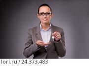 Купить «Woman holding keys in housing mortgage concept», фото № 24373483, снято 6 сентября 2016 г. (c) Elnur / Фотобанк Лори