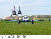Купить «Самолет L-200D и два вертолета Robinson R44, аэродром Северка. Аэрофестиваль ФЛА-2016», эксклюзивное фото № 24391991, снято 10 сентября 2016 г. (c) Alexei Tavix / Фотобанк Лори