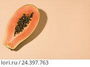 Купить «Half of a papaya,», фото № 24397763, снято 15 августа 2018 г. (c) mauritius images / Фотобанк Лори
