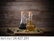Купить «olive oil and balsamic vinegar on a wooden background», фото № 24427291, снято 24 ноября 2016 г. (c) Майя Крученкова / Фотобанк Лори