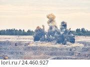 Купить «Explosion blast in open cast mining quarry mine», фото № 24460927, снято 9 сентября 2016 г. (c) Дмитрий Калиновский / Фотобанк Лори
