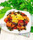 Кабачки с овощами по-гречески в тарелке на светлой доске, фото № 24461055, снято 14 октября 2016 г. (c) Резеда Костылева / Фотобанк Лори