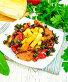 Кабачки с овощами по-гречески в тарелке на полотенце, фото № 24461063, снято 14 октября 2016 г. (c) Резеда Костылева / Фотобанк Лори
