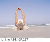 Купить «Sandy beach, woman, yoga practise, Siddhasana variation, bent forward, arms rised, Best Age, 50-60 years, long-haired, grey-haired, sports clothes, gymnastics...», фото № 24469227, снято 28 сентября 2005 г. (c) mauritius images / Фотобанк Лори