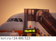 "Купить «Airport, air liner, gangway, airport vehicle, stroke ""Follow me"" landing field, airplane, preparations, stairs, boarding, transport, promotion, transportation...», фото № 24486523, снято 6 ноября 2003 г. (c) mauritius images / Фотобанк Лори"