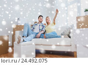 Купить «couple with boxes moving to new home and dreaming», фото № 24492075, снято 25 февраля 2016 г. (c) Syda Productions / Фотобанк Лори