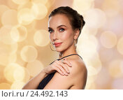 Купить «beautiful woman in black wearing diamond jewelry», фото № 24492143, снято 14 апреля 2016 г. (c) Syda Productions / Фотобанк Лори