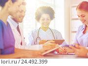 Купить «group of happy doctors meeting at hospital office», фото № 24492399, снято 14 марта 2015 г. (c) Syda Productions / Фотобанк Лори