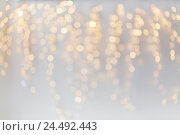 Купить «christmas decoration or garland lights bokeh», фото № 24492443, снято 15 октября 2016 г. (c) Syda Productions / Фотобанк Лори
