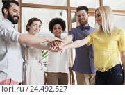 Купить «happy creative team ith hands on top in office», фото № 24492527, снято 29 марта 2015 г. (c) Syda Productions / Фотобанк Лори
