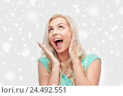 Купить «surprised smiling young woman or teenage girl», фото № 24492551, снято 13 февраля 2016 г. (c) Syda Productions / Фотобанк Лори