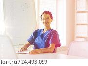 Купить «happy female doctor or nurse writing to clipboard», фото № 24493099, снято 14 марта 2015 г. (c) Syda Productions / Фотобанк Лори