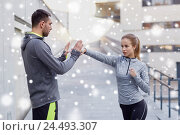 Купить «woman with coach working out strike outdoors», фото № 24493307, снято 17 октября 2015 г. (c) Syda Productions / Фотобанк Лори