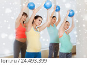 Купить «happy pregnant women exercising with ball in gym», фото № 24493399, снято 5 марта 2016 г. (c) Syda Productions / Фотобанк Лори