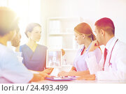 Купить «group of doctors with x-ray on tablet pc at clinic», фото № 24493499, снято 14 марта 2015 г. (c) Syda Productions / Фотобанк Лори
