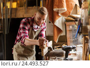 Купить «carpenter working with plane and wood at workshop», фото № 24493527, снято 14 мая 2016 г. (c) Syda Productions / Фотобанк Лори