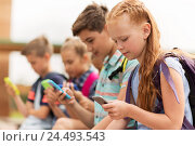 Купить «elementary school students with smartphones», фото № 24493543, снято 24 июля 2016 г. (c) Syda Productions / Фотобанк Лори