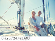 Купить «senior couple hugging on sail boat or yacht in sea», фото № 24493603, снято 18 августа 2015 г. (c) Syda Productions / Фотобанк Лори