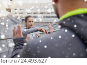 Купить «woman with trainer working out self defense strike», фото № 24493627, снято 17 октября 2015 г. (c) Syda Productions / Фотобанк Лори