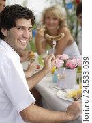 Купить «Grill party, table, man, sausage, spear, smile,», фото № 24533039, снято 1 апреля 2008 г. (c) mauritius images / Фотобанк Лори