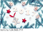 Купить «New Year 2017 background with 2017 figures,Christmas toys, framing fir branches-New Year 2017 still life», фото № 24560711, снято 30 ноября 2016 г. (c) Зезелина Марина / Фотобанк Лори