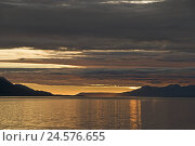 Купить «Argentina, Ushuaia, beagle channel, sunrise, morning, morning mood, scenery, mountains, heavens, clouds, waters, reflexion,», фото № 24576655, снято 4 октября 2010 г. (c) mauritius images / Фотобанк Лори