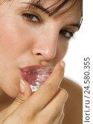 Купить «Woman, young, portrait, ice cube, lips, view camera,», фото № 24580355, снято 3 апреля 2008 г. (c) mauritius images / Фотобанк Лори