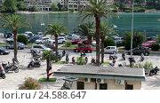 Купить «Площадь около набережной перед старым городом с припаркованными на ней мотоциклами. Котор, Черногория», видеоролик № 24588647, снято 19 октября 2016 г. (c) Кекяляйнен Андрей / Фотобанк Лори