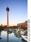 Купить «Germany, Düsseldorf, Rheinturm reflecting in the marina of the media harbour at sunset,», фото № 24597435, снято 25 мая 2019 г. (c) mauritius images / Фотобанк Лори