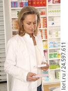 Купить «Pharmacist considered pharmaceuticals,», фото № 24597611, снято 16 августа 2018 г. (c) mauritius images / Фотобанк Лори