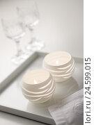 Купить «Two white tea light candles,», фото № 24599015, снято 23 июня 2018 г. (c) mauritius images / Фотобанк Лори