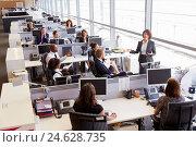 Купить «Asian female manager addressing workers in open plan office», фото № 24628735, снято 24 июня 2015 г. (c) easy Fotostock / Фотобанк Лори