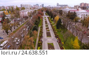 Купить «Aerial view of the russian southern city - Krasnodar. A pedestrian path. City park. 4K», видеоролик № 24638551, снято 8 декабря 2016 г. (c) ActionStore / Фотобанк Лори