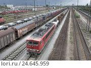 Купить «Freight trains,», фото № 24645959, снято 27 апреля 2018 г. (c) mauritius images / Фотобанк Лори