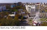 Купить «Aerial shot of the russian south city - Krasnodar. Panorama of the city. Ferris wheel. Big wheel. 4K», видеоролик № 24665843, снято 9 декабря 2016 г. (c) ActionStore / Фотобанк Лори