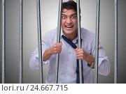 Купить «Young businessman behind the bars in prison», фото № 24667715, снято 9 декабря 2019 г. (c) Elnur / Фотобанк Лори